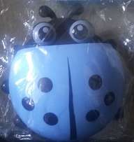 Lady Bug shaped tooth brush and paste holder