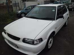 A toyota tazz 2002 model c/d player, central locking, white in color,