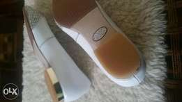 Doll shoes size five