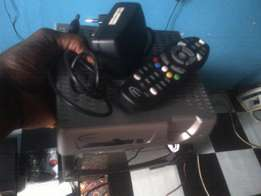 DStv with smart card and remote control