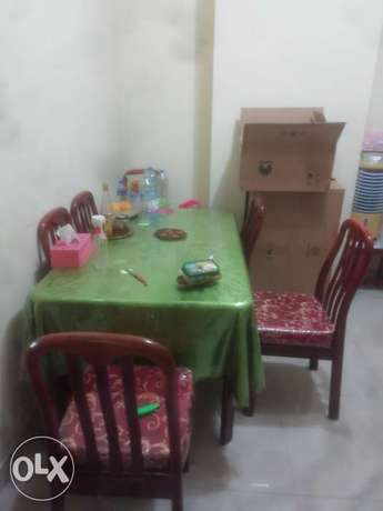Dinning table with 6 chairs with cusions, well maintained and good con