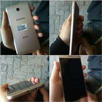 J7 prime with box and back cover..