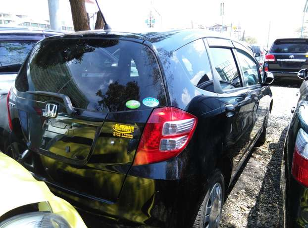 Black 2009 Honda Fit,1300CC,Grey Interiors,Dvd Player,Alloy rims Wheel Nairobi CBD - image 5