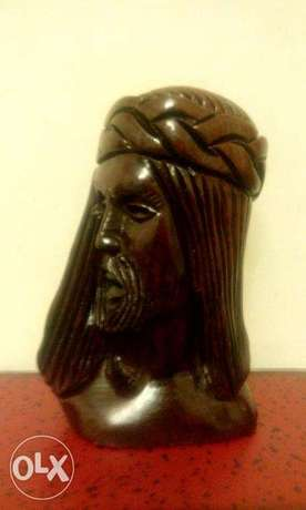 jesus head carved on wood