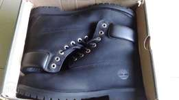 Almost brand new black Timberland Boots in carton for #22,000