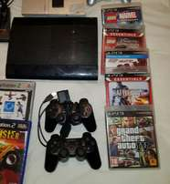 ps3 1 remotes and 5 games for sale 500gb