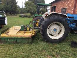 Ford 7610 Tractor with 180 Falcon Haymaker for sale