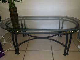 Glass top cast iron coffee table for sale.