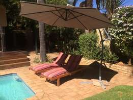 Deck Chairs and Umbrella