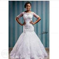 White mermaid wedding gown for rent