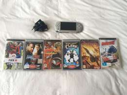 PSP + 6 games and charger.