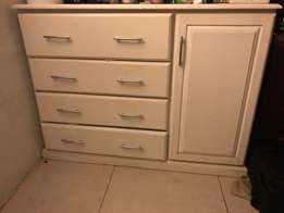 chest of drawers and side cupboard
