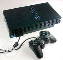 PlayStation 2 with wireless and wired pad .