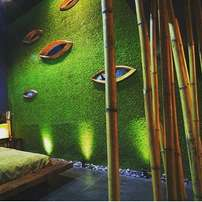 wall design with green grass rugs