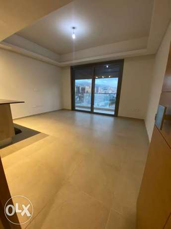 check 1 bedroom with roof for rent water front city dbayeh maten