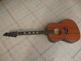 Color Black, Six stringed Acoustic Guitar With strap and pick.