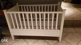 White Wooden Baby Cot