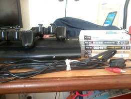 Like new PlayStation 3, 500gb slimline with 5 original games & 2 Contr