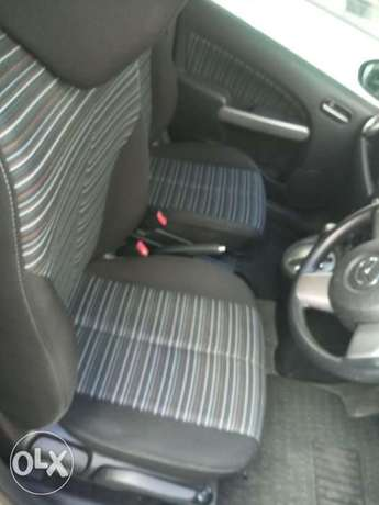 2010 model silver and black Mazda Demio for sale KCP number Mombasa Island - image 7