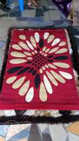 Red machine weaved center rug 3x5