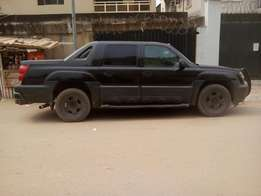 One year used Chevrolet Avalanche clean ride full option DVD etc 04