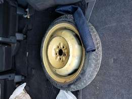 Spare tire for vehicles. Has 5 holes and fits most of the cars