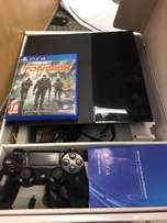 PS4 console with game and controller
