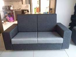 akram Abraham, two seater sofa, available on order at 300,000/-