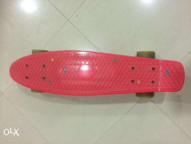 Skateboard, red color, used with a lot of care with no visible wear,