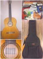 Yamaha C45 classic acoustic guitar, bag and accessories.