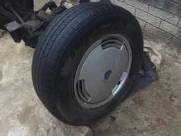 ford sierra 13 inch steel rims and tyres with oem caps