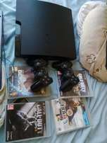 Playstation 3 for sale 2 controllers 4 Games