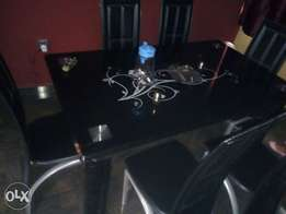 Flashy 6- sitter glass dining table
