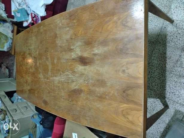 Wooden Dining Table for 10 people. It is in very good condition.