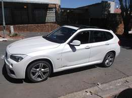 2011 BMW x1 1.8i white color with 98000km 170000