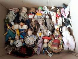 Set of 25 collectible dolls.
