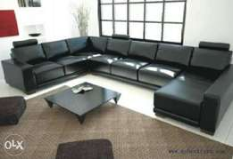 Black leather sofa with center table