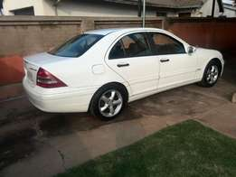 White Mercedes Benz C180