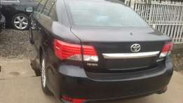 A neatly used toyota avensis 2014 model bought brand new