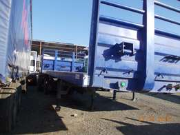 A greatly conditioned 2013 model tri - axle trailer for sale.