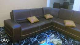 Briefly used leather sofa for sale.