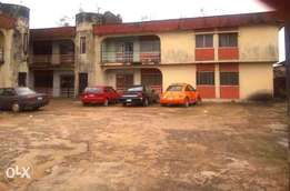 Two(2) upstairs, Six(6) flats, Double plot Ikotun