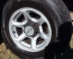Isuzu rim and NEW tyre 15inch R1500