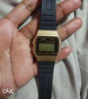 Casio black and gold resin watch