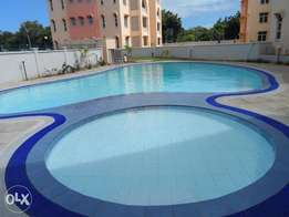 Executive 2 bedroom rental apartment with a pool at serene secure area