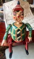 Adorable wooden sit-on-edge Pinocchio character!