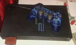 Playstation 2 with games and 1 memory card 2 remotes