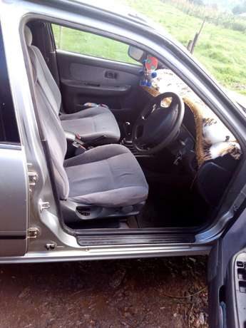 L am selling a clean crey Nissan sunny b14 ,buy and drive Kericho Town - image 3