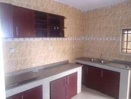 Neat 3 bedroom flat all tiles floor nice kitchen with cabinet and stor