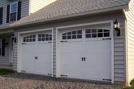Garage doors and garage door motors